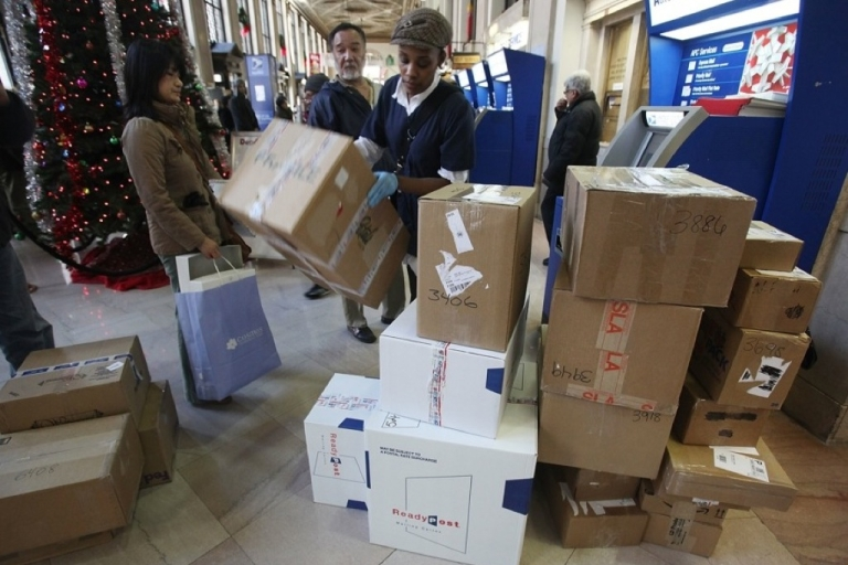 <p>A mysterious package has arrived at the University of Chicago. Here people wait on line to mail packages ahead of the Christmas holiday at the James A. Farley Post Office in Manhattan.</p>