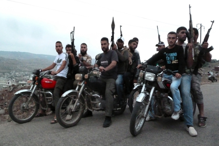 <p>Members of the Free Syrian Army ride motorbikes in the village of Azzara on the outskirts of flashpoint city of Homs on June 28, 2012.</p>