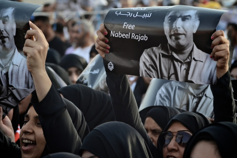 <p>Bahraini Shiite Muslim women hold portraits of opposition prisoner, Nabeel Rajab during a demonstration in the village of Karzakan, South of the capital Manama, on May 11, 2012 to demand release of jailed opposition activists.</p>