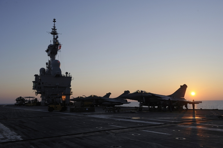 <p>French army Rafale jets fighters, are seen on March 25, 2011, on the French aircraft carrier Charles De Gaulle during the military 'Odyssey Dawn' operation in Libya.</p>