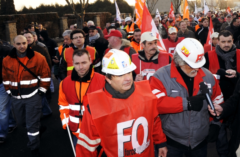 <p>Workers demonstrate at the world's largest steel maker Arcelor Mittal plant of Florange, eastern France.</p>