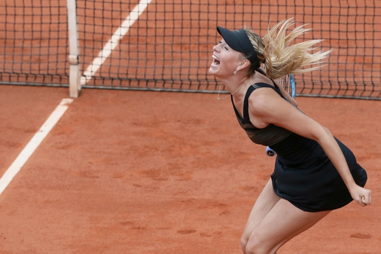 <p>Russia's Maria Sharapova reacts after winning against Italy's Sara Errani their Women's Singles final tennis match of the French Open tennis tournament at the Roland Garros stadium, on June 9, 2012 in Paris.</p>