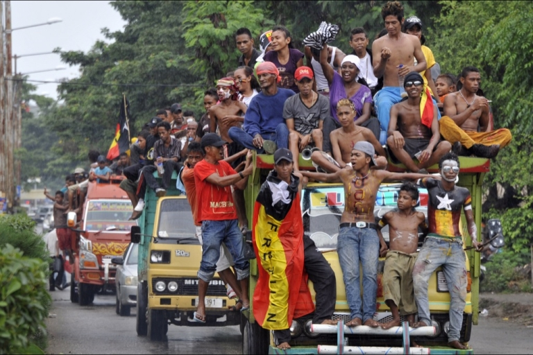 <p>Fretilin party supporters ride in a caravan as they campaign for their presidential bet Fernando 'Lu Olo' Guterres, a former guerrilla commander, on March 14, 2012. East Timor was officially recognized as independent in 2002 after 24 years of brutal Indonesian occupation.</p>