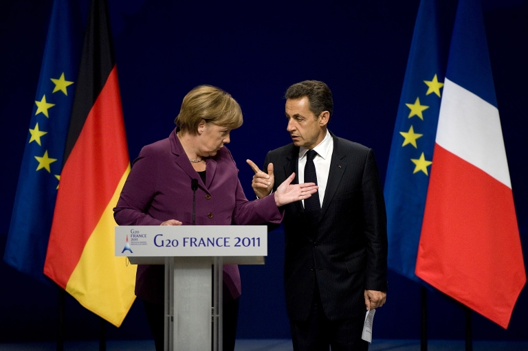 <p>German Chancellor Angela Merkel and French President Nicolas Sarkozy talk as they arrive for a press conference after a meeting with Greek Prime Minister George Papandreou and EU and IMF representatives over Eurozone bailout plan ahead of the G20 summit on November 2, 2011 in Cannes, France.</p>