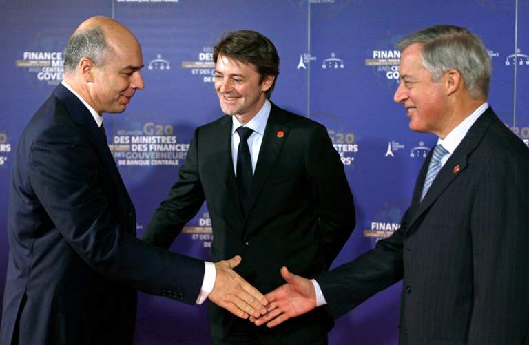 <p>Russian Finance Minister, Anton Siluanov, (L) is welcomed by Central Bank Governor Christian Noyer (R) and France's Finance Minister, Francois Baroin (C) at his arrival at the Finance Ministry in Paris.</p>