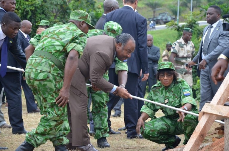 <p>Gabonese President Ali Bongo (C) gets ready to set fire to five tons of ivory worth $9.3 million on June 27, 2011 in Libreville to mark his government's commitment to battling poachers and saving elephants.</p>