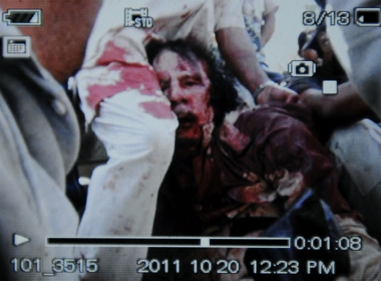 <p>THE RISE AND FALL OF GADDAFI: An image captured off a cellular phone camera shows the arrest of Libya's strongman Moamer Kadhafi in Sirte on October 20, 2011.  A Libyan National Transitional Council (NTC) commander had told AFP that Kadhafi was captured as his hometown Sirte was falling, adding that the ousted strongman was badly wounded.</p>