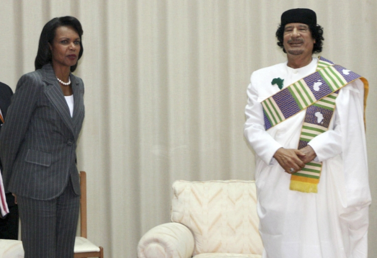 <p>Libyan leader Muammar Gaddafi poses with US Secretary of State Condoleezza Rice during her visit to Tripoli in 2008. Rebels looting Gaddafi's compound in Tripoli on August 24, 2011 found a photo album devoted to Condoleezza Rice.</p>