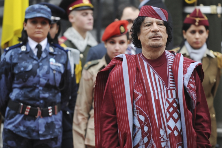 <p>Libyan leader Muammar Gaddafi with his entourage, including members of his female bodyguard unit, attend a welcoming ceremony at the presidential office in Kiev on November 4, 2008. Five of Gaddafi's former female bodyguards are claiming they were raped and abused by Gaddafi and his sons.</p>