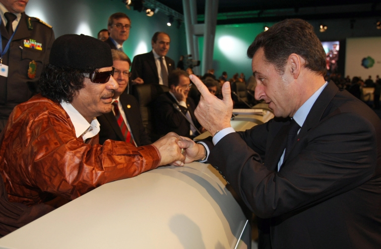 <p>Sarkozy chats with Gaddafi prior the first working session of a European Union and Africa summit in December, 2007 in Lisbon, Portugal.</p>
