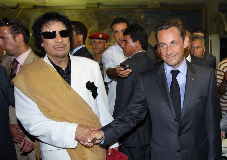 <p>Sarkozy shakes hands with Gaddafi in Tripoli upon his arrival for an official visit to Libya on July 25, 2007.</p>