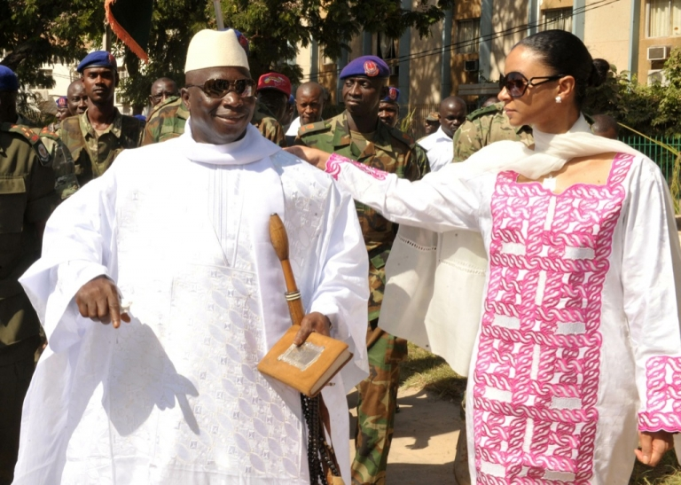 <p>Gambian incumbent Yahya Jammeh (L) speaks with his wife, Zeineb Souma Jammeh, on Nov. 24, 2011 as he leaves a polling station in the capital Banjul after voting in the presidential elections. Gambians voted on Nov. 24 in polls, which some observers said were skewed in favor of Jammeh, who heaped scorn on criticism that his regime is repressive.</p>