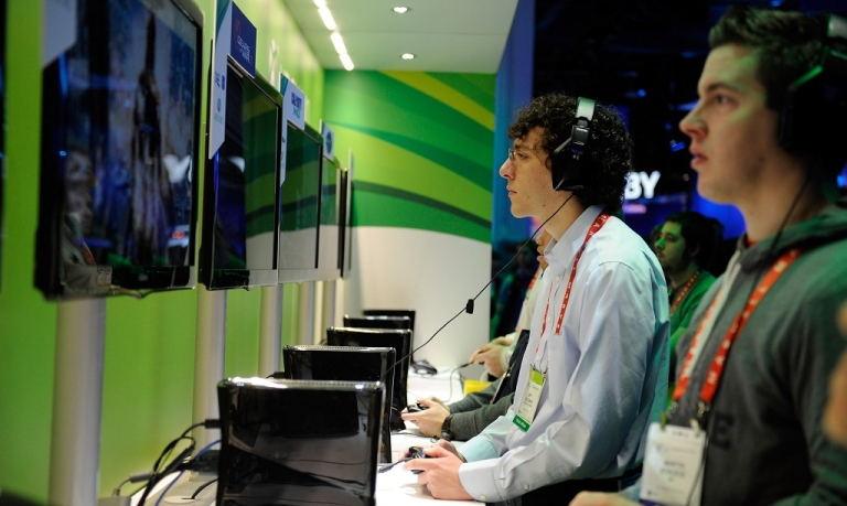 <p>Attendees play video games at Microsoft's Xbox 360 display at the 2012 International Consumer Electronics Show at the Las Vegas Convention Center January 10, 2012 in Las Vegas, Nevada. CES, the world's largest annual consumer technology trade show, runs through January 13 and is expected to feature 2,700 exhibitors showing off their latest products and services to about 140,000 attendees.</p>