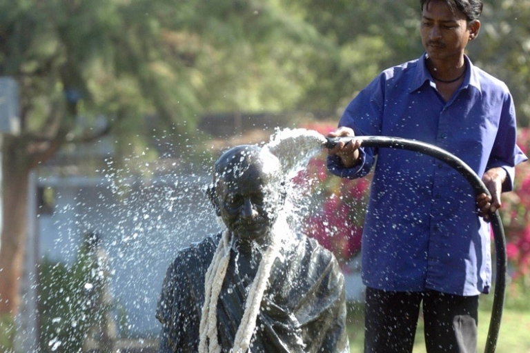 <p>A worker cleans a statue of Mahatma Gandhi in the western state of Gujarat.</p>