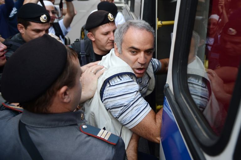 <p>Russian riot policemen detain former world chess champion and Russian opposition leader Garry Kasparov on Aug. 17, 2012, outside a court building in Moscow, where three members of the feminist punk band Pussy Riot were found guilty of hooliganism.</p>