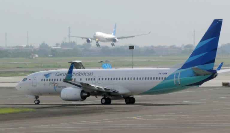 <p>A Garuda Indonesia jet lands and another prepares to take off at Soekarno-Hatta airport in Jakarta.</p>