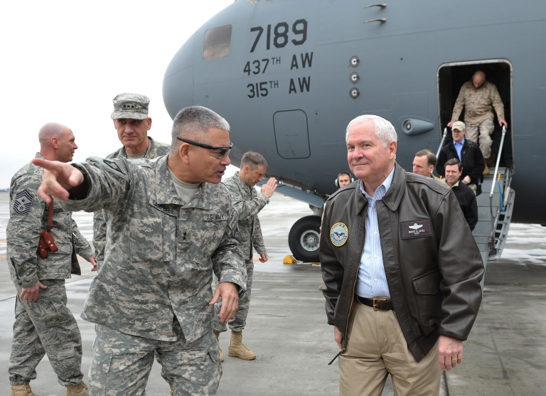 <p>Major General John Campbell greets U.S. Defense Secretary Robert Gates as he arrives on March 7, 2011 at Bagram Air Field in Afghanistan. Gates flew into Kabul to assess the US-led war effort amid tensions with Afghan President Hamid Karzai over the deaths of nine children in a NATO air strike.</p>