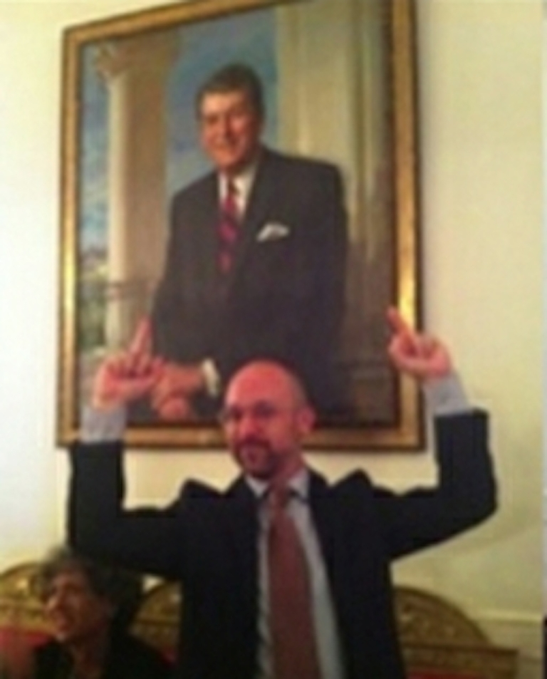 <p>White House guest Matty Hart is seen flipping off a portrait of Ronald Reagan on June 15, 2012.</p>