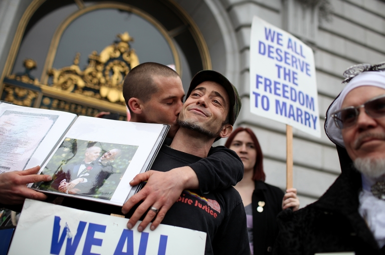 <p>Same-sex couple Frank Capley-Alfano and Joe Capley-Alfano celebrate outside of San Francisco City Hall on Feb. 7 in San Francisco, California. A three-judge panel of the 9th US Circuit Court of Appeals ruled that the voter-approved Proposition 8 measure violates the civil rights of gay men and lesbians.</p>