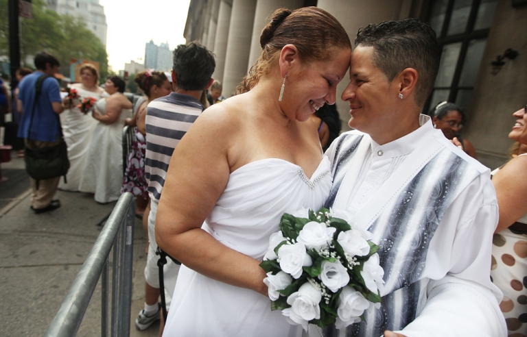 <p>Maira Garcia and Maria Vargas wait on line to get married at the Brooklyn City Clerk's office in New York City. Hawaii is set to become the 15th US state to allow gay marriage after its senate passed the bill on Nov. 12, 2013.</p>