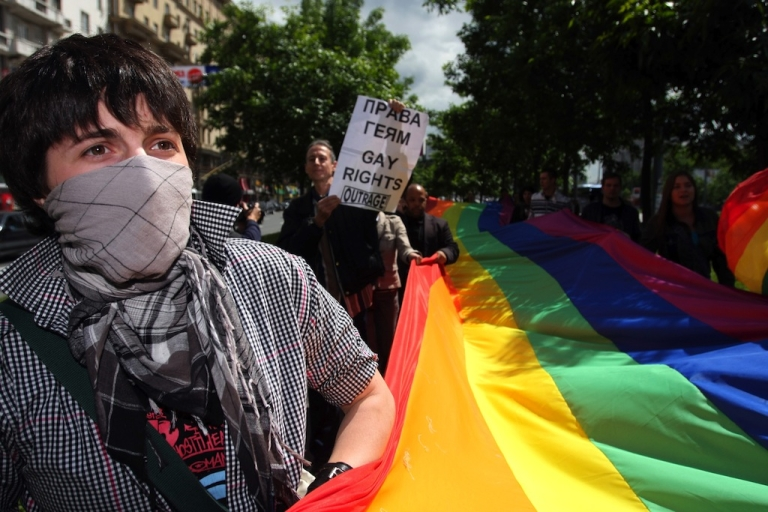 <p>Members of the Russian gay community and gay rights activists from Europe hold flags during a banned gay rally in Moscow on May 29, 2008. Gay pride parades are routinely prohibited by city authorities. The parades often end with arrests.</p>
