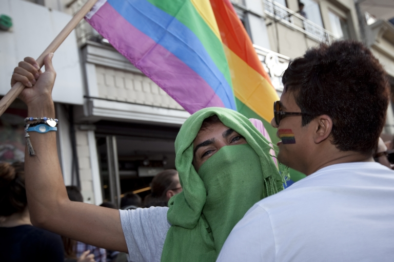 <p>Holding a rainbow flag and dressed in hijab, an LGBT supporter makes a political statement at the Gay Pride March in Istanbul on June 19, 2011. Turkey is the only Muslim-majority country that permits such an event.</p>