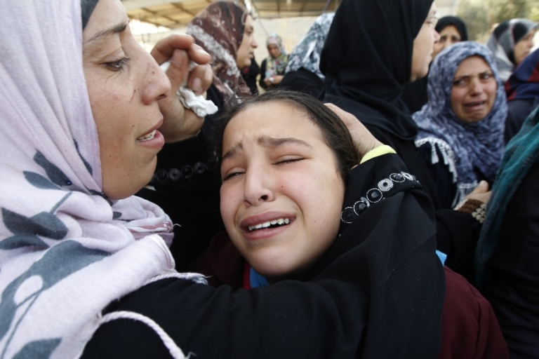 <p>Palestinian women and children cry during the funeral of Audi Naser, who was killed in an Israeli air strike, during his funeral in Beit Hanun, northern Gaza Strip, on November 16, 2012.</p>