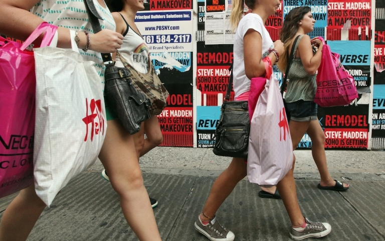 <p>Shoppers walk in New York City on July 16, 2012. Retail sales declined for a third straight month as the U.S. economic recovery remained shaky.</p>