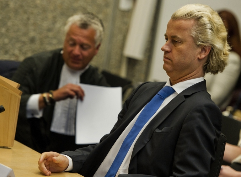 <p>Dutch anti-Islam deputy Geert Wilders (R) sits next to his lawyer Bram Moszkowicz on May 23, 2011 in court in Amsterdam. The leader of the far-right Party for Freedom (PVV) faced five counts of giving offence to Muslims and of inciting hatred against Muslims and people of non-Western immigrant origin, particularly Moroccans.</p>