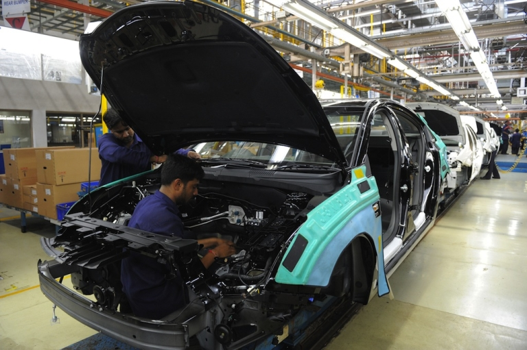 <p>An Indian laborer works in the assembly line at the General Motors India manufacturing plant in Halol, about 100 miles from Ahmedabad in the western state of Gujarat, on September 22, 2010.</p>