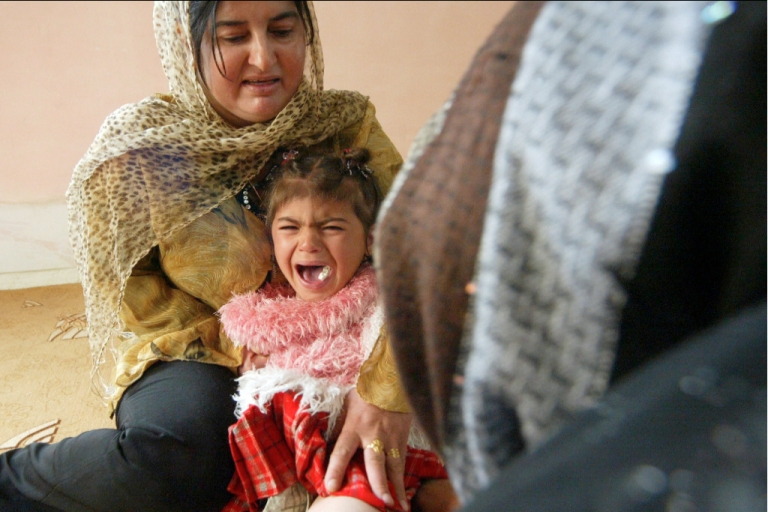 <p>Iraqi Kurdish four-year-old Shwen screams during her circumcision in Iraq in 2009.</p>