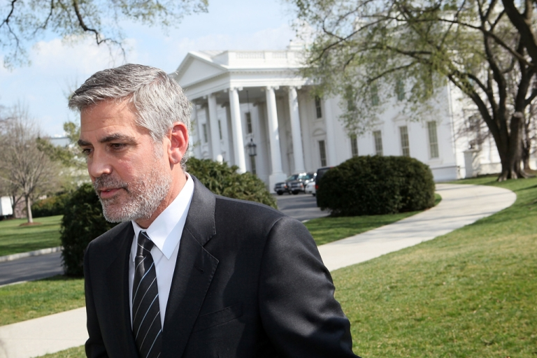 <p>Actor George Clooney leaves after he spoke to the media March 15, 2012 at the White House in Washington, DC. Clooney had meeting with President Barack Obama to discuss the current situations in Darfur, Sudan. Clooney was arrested on March 16 in front of the Sudanese embassy.</p>