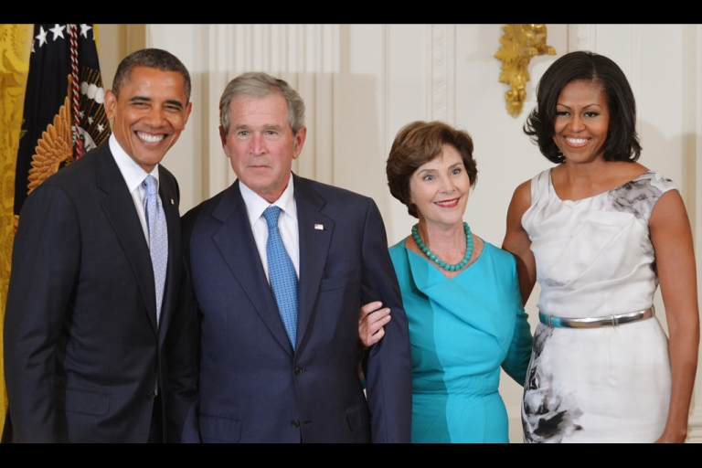 <p>US President Barack Obama (L) and First Lady Michelle Obama (R) pose with former US president George W. Bush and his wife Laura Bush during the unveiling of their portraits May 31, 2012 in the East Room of the White House in Washington, DC.</p>