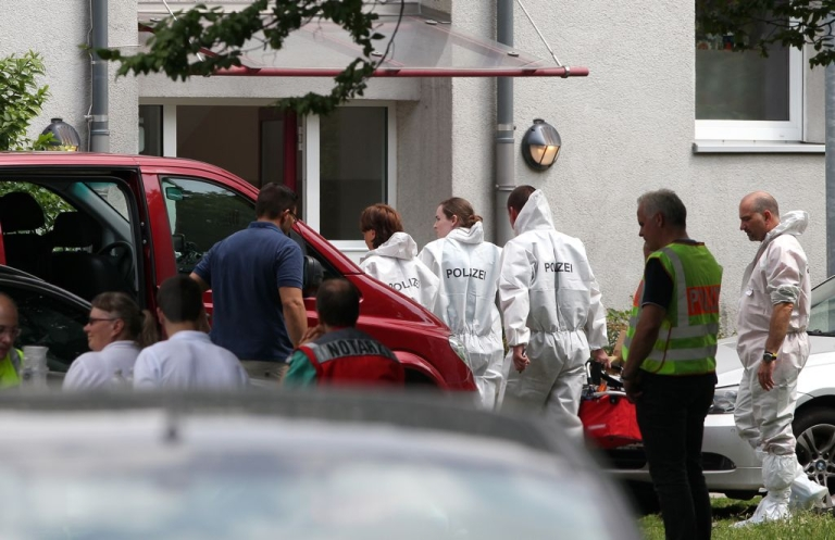 <p>Members of the forensic police enter the house where a gunman had taken several people, including a bailiff, hostage during a home eviction in Karlsruhe, southwestern Germany, on July 4, 2012.</p>
