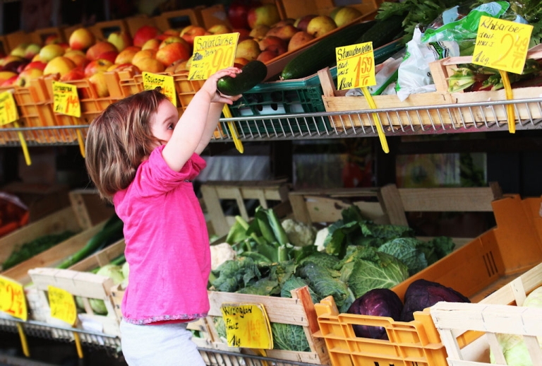 <p>A child reaches for cucumbers on May 26, 2011 in Hamburg, Germany.</p>