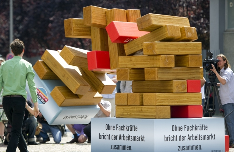<p>A tower symbolizing the labor market tumbles down after one of the red elements standing for skilled workers was pulled away on May 31, 2011 in Berlin. German unemployment fell to 7 percent of the workforce in May 2011, official data showed as the country continued to reap the benefits of labor market reforms and a global recovery.</p>