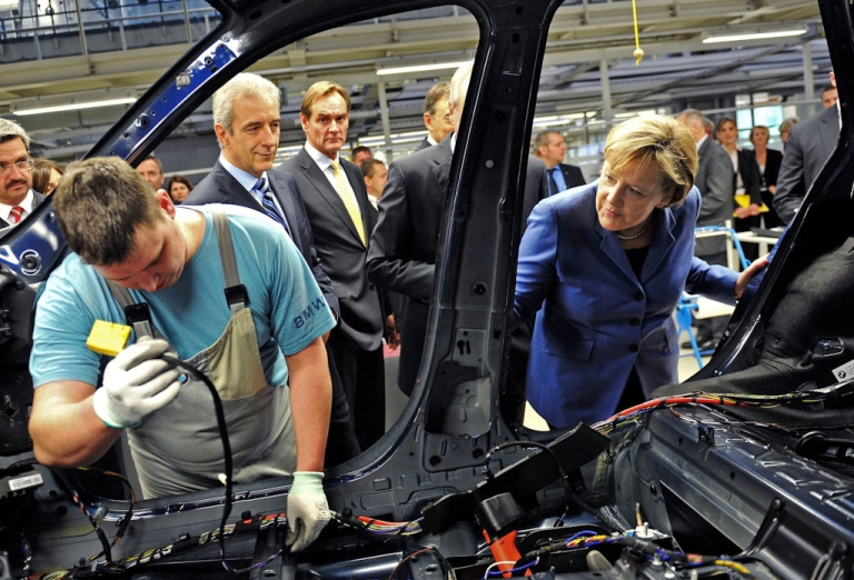 <p>German Chancellor Angela Merkel (right) visit a BMW plant in Leipzig on Nov. 5, 2010. The plant will be expanded to produce the newly-developed Megacity electric car.</p>