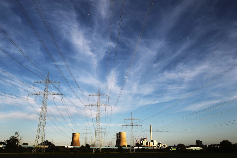 <p>The Kraftwerk Westfallen coal-burning power plant stands illuminated on May 23, 2011 in Hamm, Germany.</p>