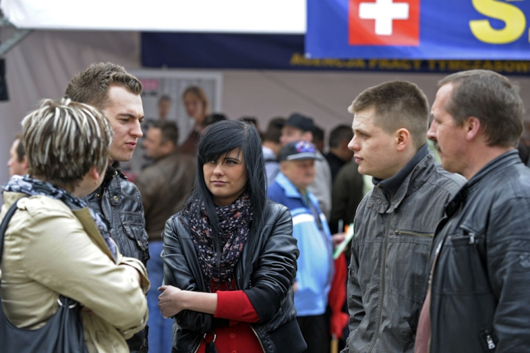 <p>People chat on April 12, 2011 during a job fair in Wroclaw, Poland. Once feared by workforces in Austria as well as Germany, the proverbial Polish plumber is now being wooed as Vienna and Berlin seek to top up a shortage of skilled laborers as they fully open their job markets on May 1 to the eastern members who joined the EU in 2004.</p>
