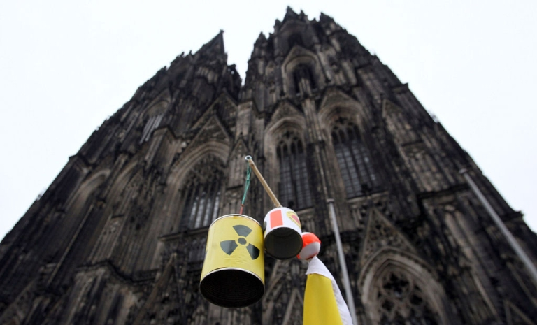 <p>The Cologne cathedral and a sign referring to the nuclear disaster at the Fukushima facility in Japan during an anti-nuclear demonstration on March 14, 2011 in Cologne, Germany. Thousands of anti-nuclear demonstrators gathered in a coordinated effort in cities across Germany to protest against the government-granted extension of the operational lives of Germany's older nuclear power plants.</p>