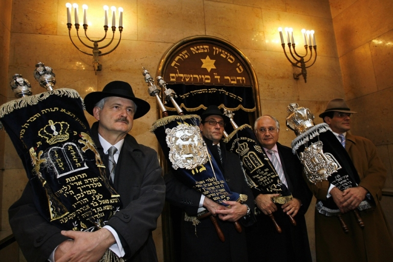 <p>Members of Munich's Jewish community bring the Torah scroll to the new synagogue in Munich, southern Germany, ahead of its official inauguration on Nov. 9, 2006, 68 years to the day after a Nazi mob destroyed Munich's main synagogue. A new study finds high levels of anti-Semitism in mainstream German culture.</p>