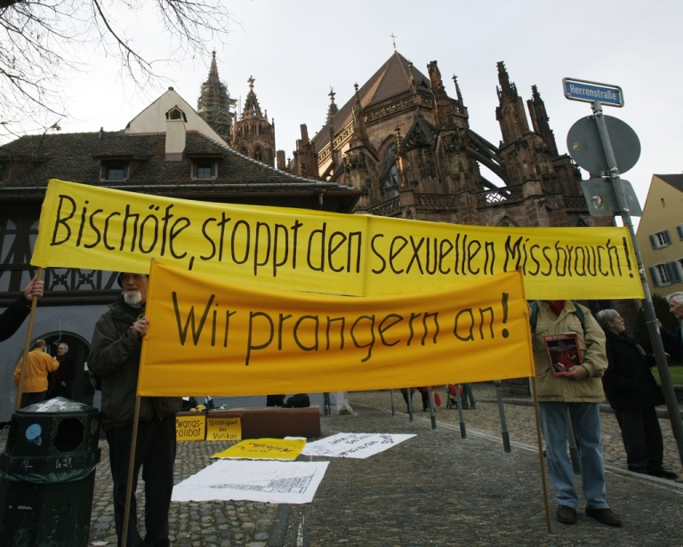 <p>Protesters hold a banner which reads 'Bishops, stop the sexual abuse' in the southern German city of Freiburg on February 22, 2010.</p>