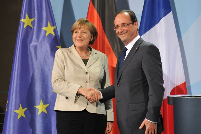 <p>German Chancellor Angela Merkel and the new French president Francois Hollande shakes hands after their joint press conference on May 15, 2012 in Berlin. Hollande met Merkel for their first talks on the debt crisis as Greece's future in the eurozone appears uncertain.</p>