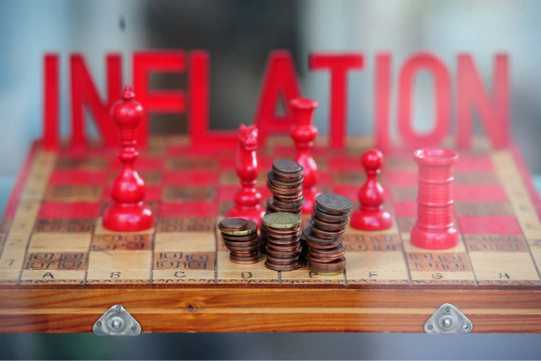 <p>Inflation threatens euro cents in a Berlin advertisement.</p>