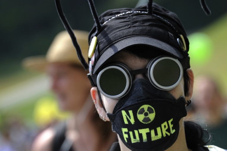 <p>A demonstrator attends a protest on May 22, 2011, in Dottingen, northern Switzerland against nuclear power.</p>