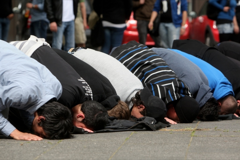 <p>Salafist supporters pray as they counter-protest against a demonstration by right-wing pro NRW supporters outside the new Central Mosque (Zentralmoschee) in Ehrenfeld district, on May 8, 2012 in Cologne, Germany.</p>