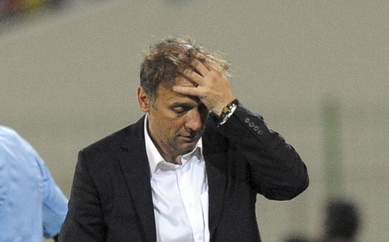 <p>Ghana's Serbian coach Goran Stevanovic reacts during the third-place playoff Africa Cup of Nations football match between Mali and Ghana, in Malabo, on Febuary 11, 2012. Mali won the match 2-0.</p>