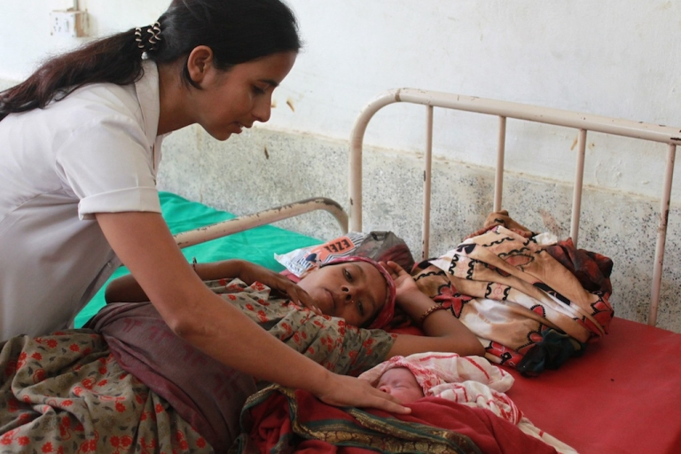 <p>Staff nurse Dila Bhusal checks on a patient who recently delivered a baby at the Lamahi Primary Healthcare Center in Nepal's Dang district.</p>