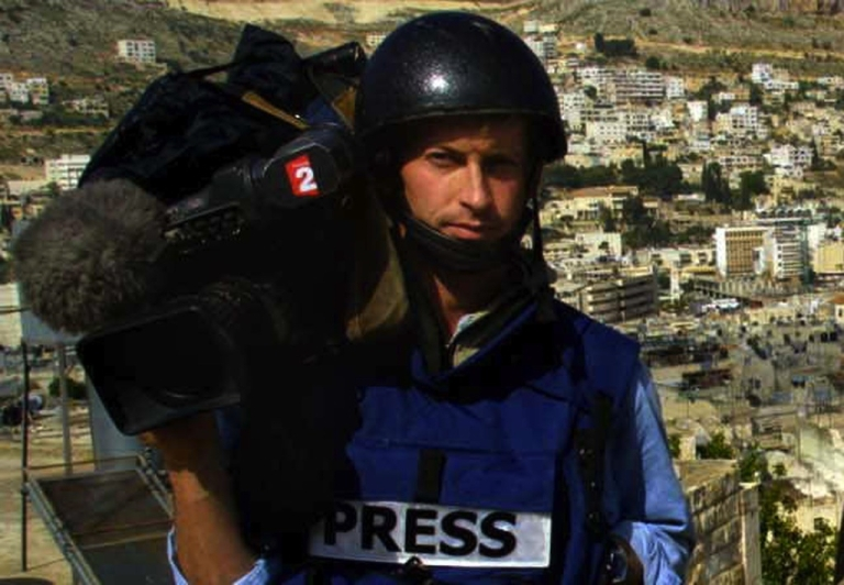 <p>A picture taken on April 9, 2002 shows cameraman Gilles Jacquier from French TV 2 posing in the West Bank city of Nablus. French television reporter Gilles Jacquier was kiled by a shell in the flashpoint city of Homs on January 11, 2012, becoming the first Western journalist to be killed in 10 months of deadly unrest across Syria. According to an AFP reporter at the scene, a shell exploded amid a group of journalists covering demonstrations in the city of Homs, a centre of opposition to the regime of President Bashar al-Assad. Several more people were reported wounded in the blast, which occurred as the reporters were on a visit organized by the Syrian authorities.</p>