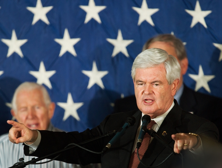 <p>Republican presidential hopeful Newt Gingrich speaks to supporters at Dolphin Aviation in Sarasota, Fla., on Jan. 24, 2012.</p>